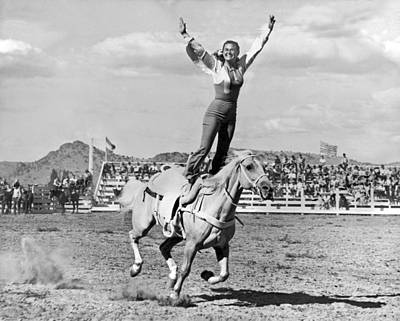 Photograph - A Trickriding Cowgirl by Underwood Archives