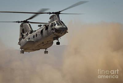 Down On The Ground Photograph - A U.s. Marine Corps Ch-46e Sea Knight by Stocktrek Images