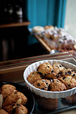 Photograph - A Variety Of Scones For Sale On Display by Halfdark