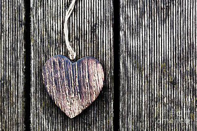 Design Photograph - A Wooden Vintage Heart On Grunge Wood Planks by Michal Bednarek