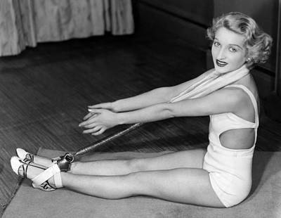 Exercise Photograph - A Young Woman Exercising by Underwood Archives