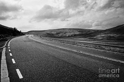 Carriageway Photograph - A6 Road Through The Countryside Near Shap In Cumbria Uk by Joe Fox