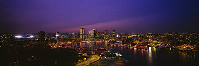Urban Scenes Photograph - Aerial View Of A City Lit Up At Dusk by Panoramic Images