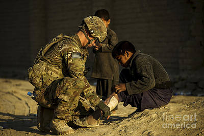 Airman Provides Medical Aid To A Local Art Print by Stocktrek Images