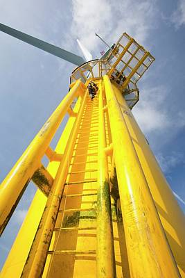 Rotor Blades Photograph - An Engineer Climbs A Transition Piece by Ashley Cooper