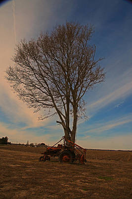 Photograph - Antique Tractor At Sunset by Ronald Olivier