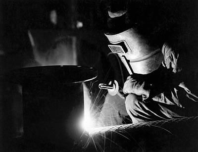 Arc Welder Photograph - Arc Welder At Work by Underwood Archives