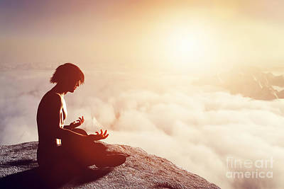 Cloudscape Photograph - Asian Man Meditates In Yoga Position by Michal Bednarek