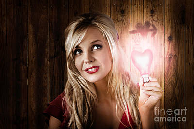 Attractive Young Blond Girl Holding Love Light Art Print by Jorgo Photography - Wall Art Gallery