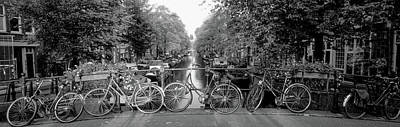 Bicycles On Bridge Over Canal Art Print