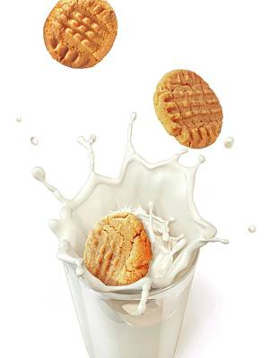 Biscuits Splashing Into Milk Art Print by Leonello Calvetti