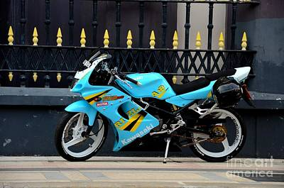 Photograph - Blue Yellow Sporty Motorcycle Parked On Pavement Singapore by Imran Ahmed