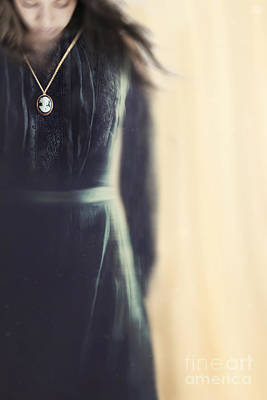Photograph - Blurred Image Of A Black Mourning Dress With Cameo by Sandra Cunningham