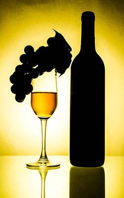 Bottle And Wine Glass Art Print by Sirapol Siricharattakul