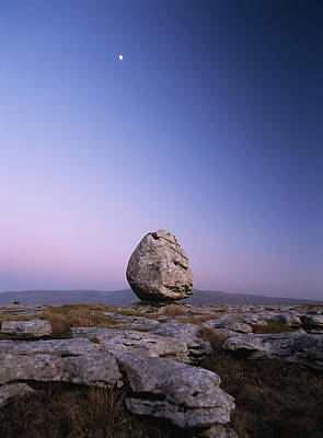 Boulder On Limestone Pavement At Dusk Art Print by Ian Cumming
