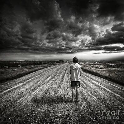 Photograph - Boy Walking On Dark Lonely Road In Early Evening  by Sandra Cunningham