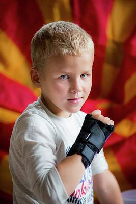 Boy With Brace On Broken Wrist Art Print by Samuel Ashfield