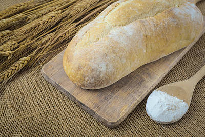 Bread On Bread Board With Wheat And Flour Filled Spoon On Burlap Art Print by Brandon Bourdages