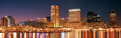 Building Exterior Photograph - Buildings Lit Up At Dusk, Baltimore by Panoramic Images