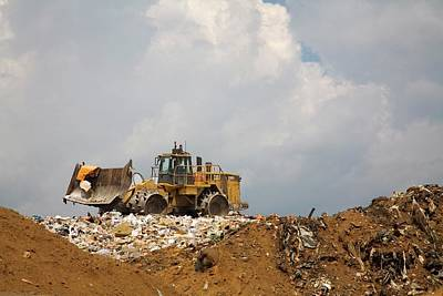 Bulldozer Photograph - Bulldozer On A Landfill Site by Jim West
