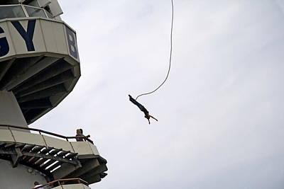 Scheveningen Pier Photograph - Bungee Jumping From The Pier In Scheveningen Netherlands by Ronald Jansen