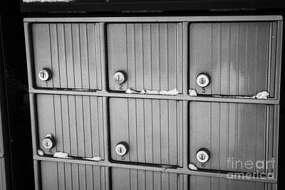Harsh Conditions Photograph - canada post post mailboxes in rural small town Forget Saskatchewan Canada by Joe Fox