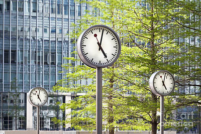 Overtime Photograph - Canary Wharf Clocks In London by Roberto Morgenthaler