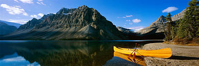 Canoe Photograph - Canoe At The Lakeside, Bow Lake, Banff by Panoramic Images