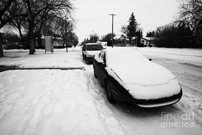 car covered in snow parked on street in pleasant hill Saskatoon Saskatchewan Canada Art Print by Joe Fox