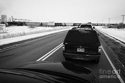 Sask Photograph - cars waiting on train crossing trans-canada highway in winter outside Yorkton Saskatchewan Canada by Joe Fox