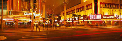 Crosswalks Photograph - Casino Lit Up At Night, Fremont Street by Panoramic Images