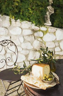 Cheese, Green Olives, Crackers And Olive Oil On Outdoor Table Art Print