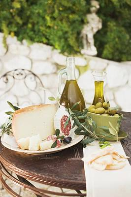 Cheese, Salami, Olives, Olive Oil, Crackers On Outdoor Table Art Print