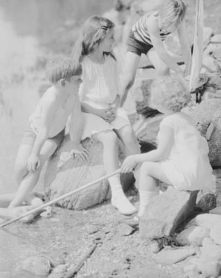 Children Playing Beside A Pond Art Print