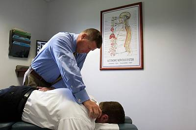Chiropractor Photograph - Chiropractor Manipulating Patient by Jim West