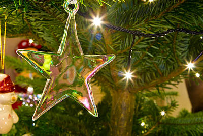 Gold Leaf Ring Photograph - Christmas Star Hanging On The Christmas Tree by Fizzy Image