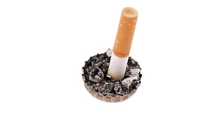 Photograph - Cigarette Butt And Ash In A Bottle Cap by Marek Poplawski