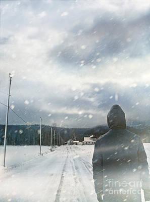 Photograph - Closeup Of Man Walking On Snowy Winter Road by Sandra Cunningham