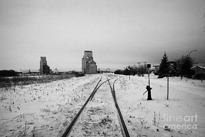 Cn Canadian National Railway Tracks And Grain Silos Kamsack Saskatchewan Canada Art Print by Joe Fox