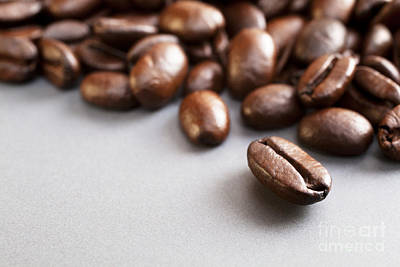 Coffee Beans On Grey Ceramic Surface Art Print by Colin and Linda McKie