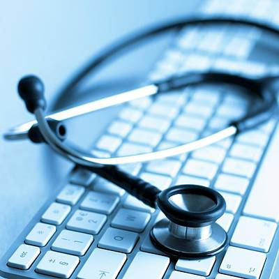 Keyboards Photograph - Computer Keyboard And Stethoscope by Science Photo Library