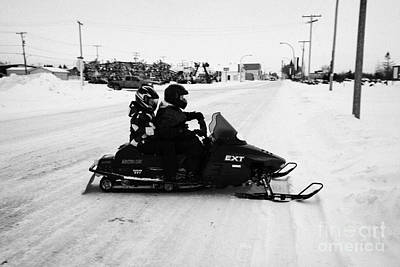 Sask Photograph - couple on a snowmobile Kamsack Saskatchewan Canada by Joe Fox