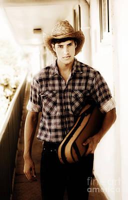Cowboy Carrying Guitar Art Print by Jorgo Photography - Wall Art Gallery