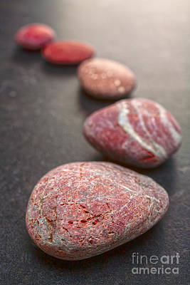 Superhero Ice Pops - Curving Line of Red and Grey Pebbles on Dark Background by Colin and Linda McKie