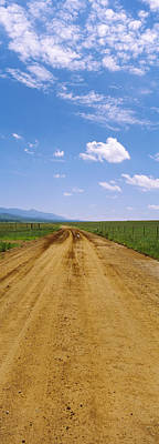 San Rafael Photograph - Dirt Road Passing Through A Landscape by Panoramic Images