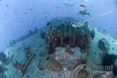 Mohammad Photograph - Divers At A Shipwreck, Ras Mohammed by PhotoStock-Israel