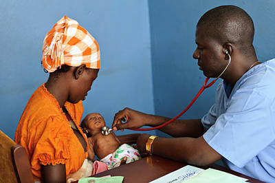 West Africa Photograph - Doctor Examining A Baby by Matthew Oldfield