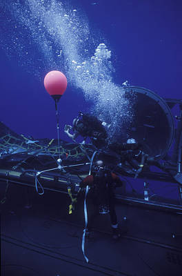 Inflatable Rafts Photograph - Dry Deck Shelter Operators Retrieve by Michael Wood