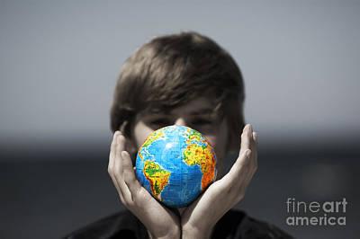 Photograph - Earth Globe In Hands. Conceptual Image by Michal Bednarek
