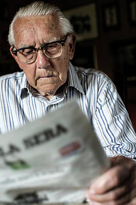 Elderly Man Reading A Newspaper Art Print by Mauro Fermariello